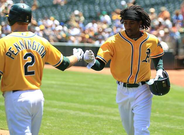 Jemile Weeks #19 of the Oakland Athletics celebrates with Cliff Pennington after scoring on a single by Coco Crisp against the Kansas City Royals at the Oakland-Alameda County Coliseum on June 16, 2011 in Oakland, California. Photo: Jed Jacobsohn, Getty Images