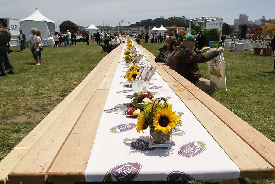 A picnic table, set up on the Marina Green in San Francisco Calif., on June 18, 2011, broke the Guinness world record for the longest measuring 305 feet, 3 inches. Photo: Audrey Whitmeyer-Weathers, The Chronicle