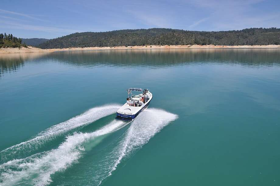 A boat makes waves on the glassy water at Bullards Bar Reservoir Photo: Debra Robertson, Emerald Cove Marina