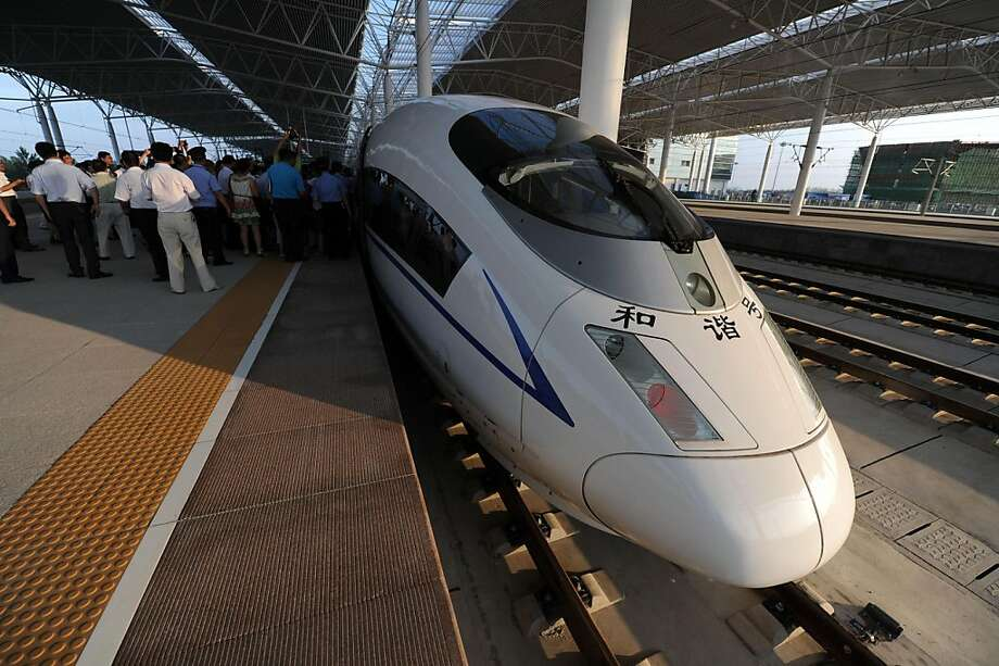 A high-speed train arrives at the Bengbu station, east China's Anhui province, one of the stops of the Beijing to Shanghai line which was launched on June 30, 2011.  High-speed trains linking Beijing and Shanghai made their passenger debut on a USD33 billion track China hopes will help ease its overloaded transport system.          CHINA OUT Photo: Str, AFP/Getty Images