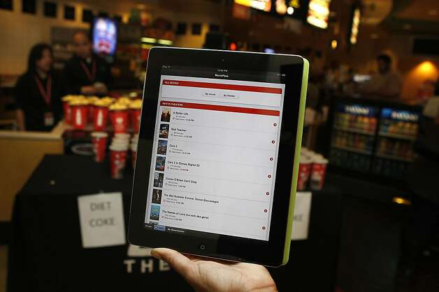 Looking at list of MoviePass movies on an Ipad at AMC in San Francisco, Calif., on Wednesday, January 29, 2011.  MoviePass is a new mobile service that lets people go to as many movies as they want for $50 a month. They use their phone as their ticket into the theater. They also get to see trailers and other promotions through the mobile service. Photo: Liz Hafalia, The Chronicle
