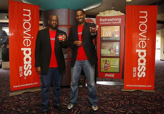 "MoviePass co-founders Stacy Spikes (left) and Hamet Watt (right) at AMC in San Francisco, Calif., on Wednesday, January 29, 2011.  MoviePass is a new mobile service that lets people go to as many movies as they want for $50 a month. They use their phone as their ticket into the theater. Billed as the ""Netflix for movie theater goers, you can also get to see trailers and other promotions through the mobile service. Photo: Liz Hafalia, The Chronicle"