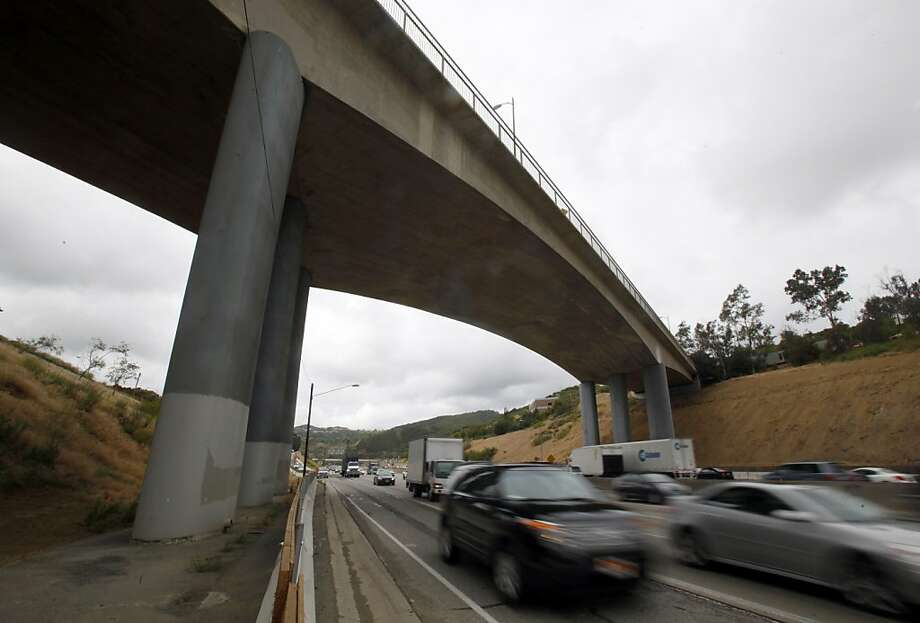 "The Mulholland Drive bridge over Interstate 405, which crosses the Santa Monica Mountains connecting the San Fernando Valley and the Westside of Los Angeles, is seen Monday, June 6, 2011. Los Angeles authorities are bracing for a full-blown traffic nightmare when a section of vital route undergoes a weekend closure this summer.  Los Angeles County Supervisor Zev Yaroslavsky said motorists should stay away from the area to prevent what he terms ""car-mageddon.""  A 10-mile stretch of the 405 through Sepulveda Pass will be closed for 53 hours for demolition of half of the bridge in mid-July. (AP Photo/Reed Saxon) Photo: Reed Saxon, ASSOCIATED PRESS"