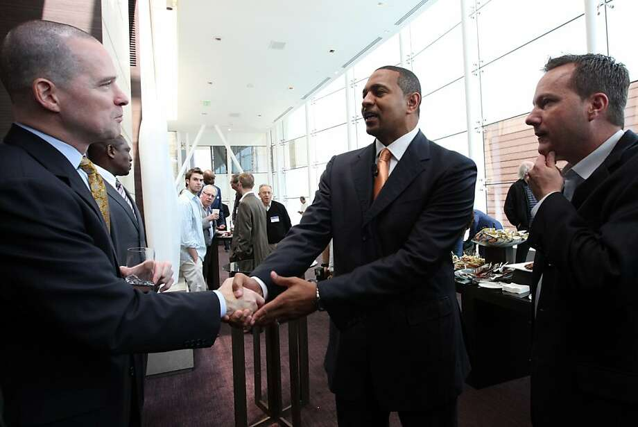 The Golden State Warriors new Head Coach, Mark Jackson, shakes hands with his assistant coach, Michael Malone, left, before a press conference at the St. Regis Hotel in San Francisco, CA Friday, June 10, 2011. Photo: Erin Lubin, Special To The Chronicle