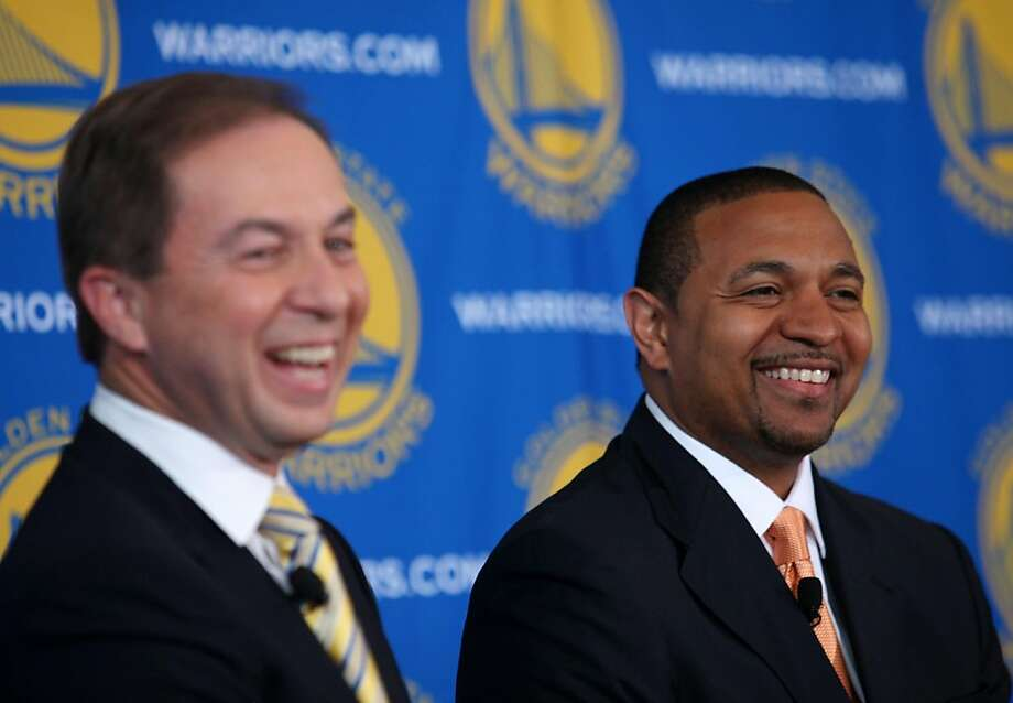 New Golden State Warriors' coach Mark Jackson, right, shares a laugh with team owner Joe Lacob, left, during a news conference on Friday, June 10, 2011 in San Francisco, Calif. Photo: Jane Tyska, AP