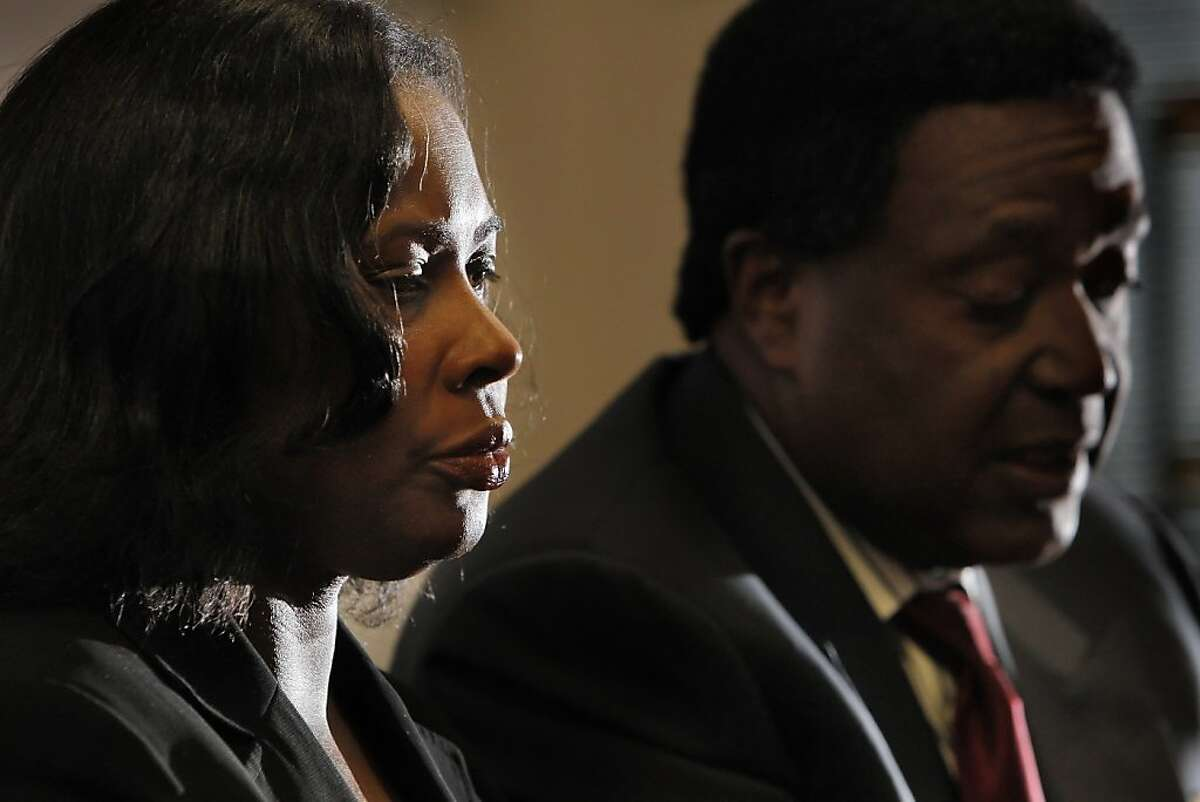 Wanda Johnson, mother of Oscar Grant, listens to her attorney, John Burris tell the media about her settlement with BART. Johnson settled with BART over her son's shooting for $1.3 million on Tuesday, June 28, 2011. The settlement was announced at the office of her lawyer, John Burris, in Oakland, Calif.