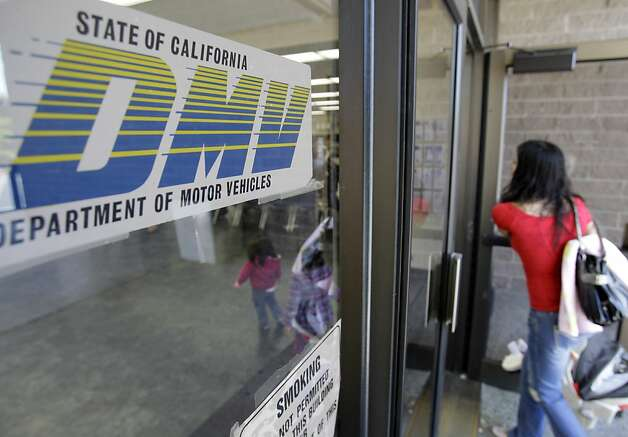A customer walks into a Department of Motor Vehicles office in Redwood City, Calif., Thursday, June 30, 2011. All Californians with a vehicle will pay $12 more a year to register it and millions of property owners who live outside cities will pay $150 a year for state fire protection. Those are among the new fees included in the state budget passed late Tuesday night without any Republican support. Photo: Paul Sakuma, AP