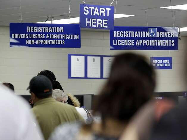 Customers wait in line at a Department of Motor Vehicles office in Redwood City, Calif., Thursday, June 30, 2011. All Californians with a vehicle will pay $12 more a year to register it and millions of property owners who live outside cities will pay $150a year for state fire protection. Those are among the new fees included in the state budget passed late Tuesday night without any Republican support. Photo: Paul Sakuma, AP