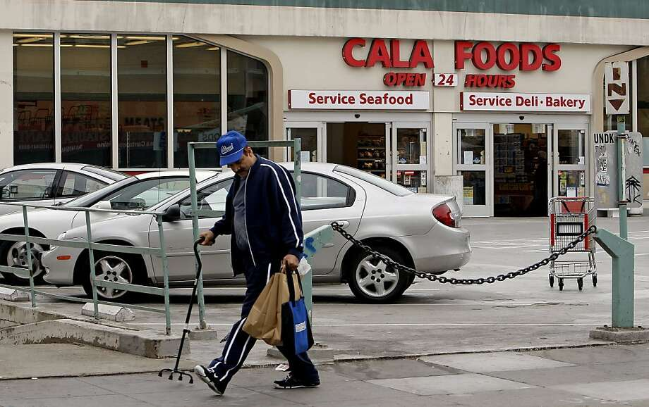 Shopper, Taha Baabbad of San Francisco, heads to the bus stop after getting his groceries at the Cala Foods Supermarket on the corner of Hyde and California Streets in San Francisco, Calif. on Wednesday Sept. 16, 2008. Photo: Michael Macor, The Chronicle