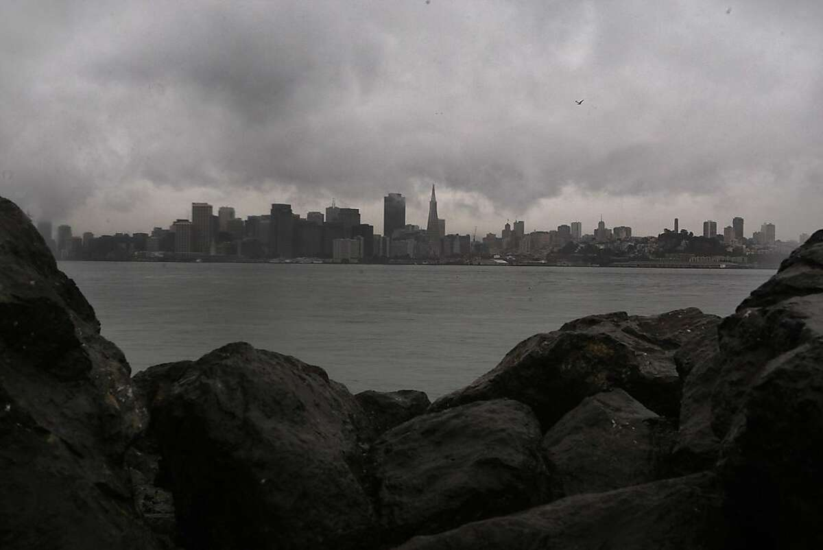 Clouds loom over the skyline of the city as seen from on Yerba Buena Island, Calif., on Tuesday, January 28, 2011.