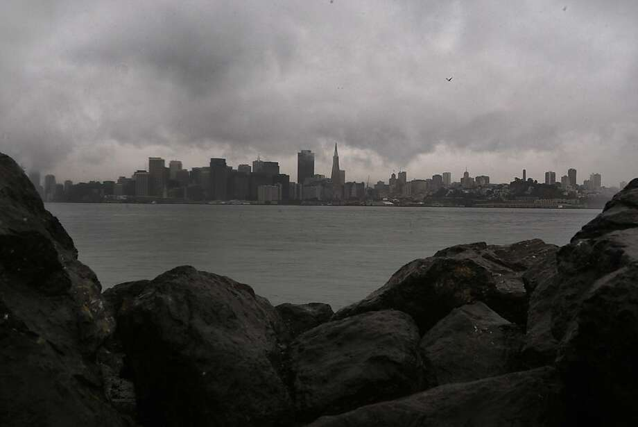 Clouds loom over the skyline of the city as seen from on Yerba Buena Island, Calif., on Tuesday, January 28, 2011. Photo: Liz Hafalia, The Chronicle