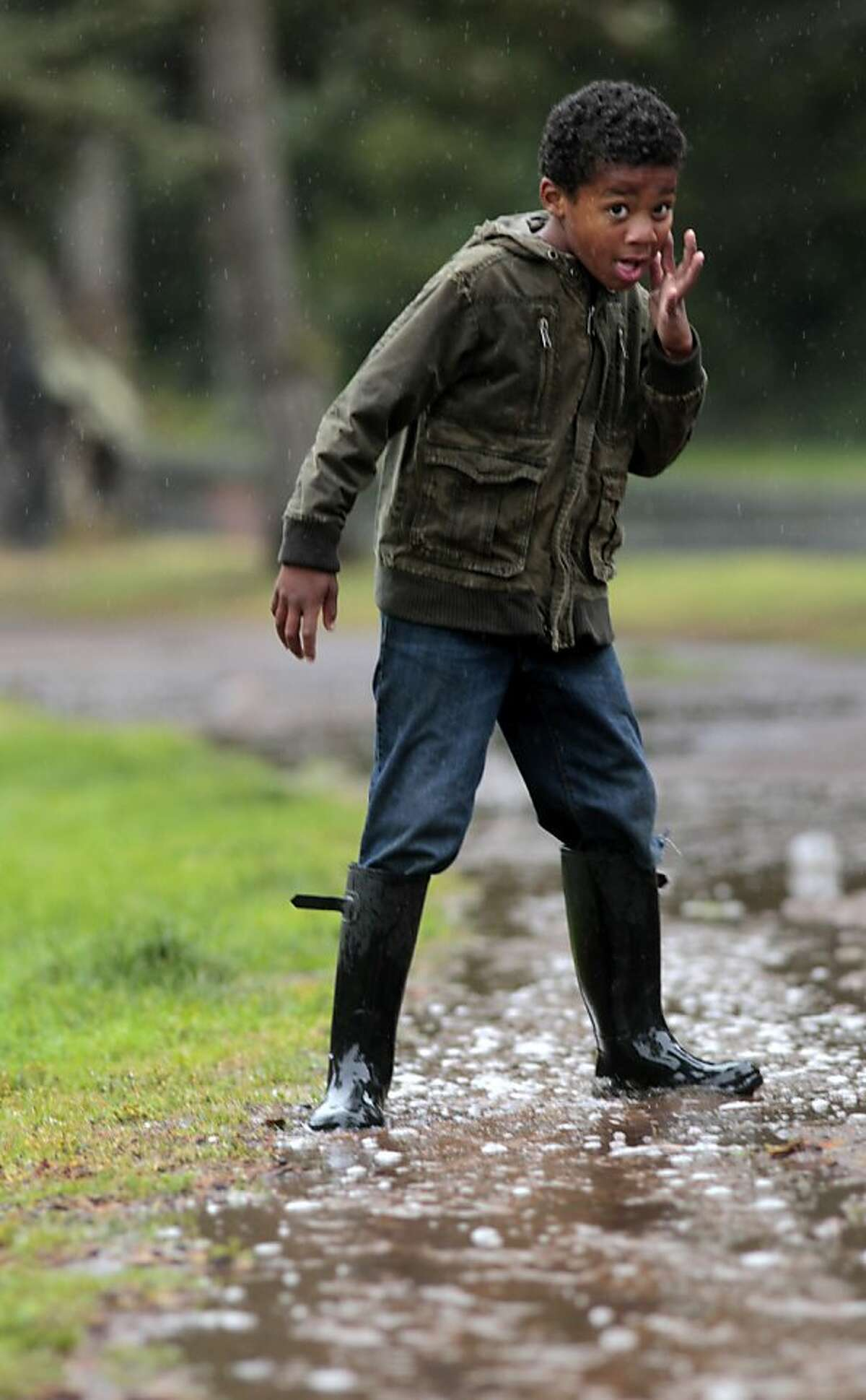 Kobi Davis , 8 years old, stomps in the rain puddles in Golden Gate Park,Tuesday June 28, 2011, in San Francisco, Calif.