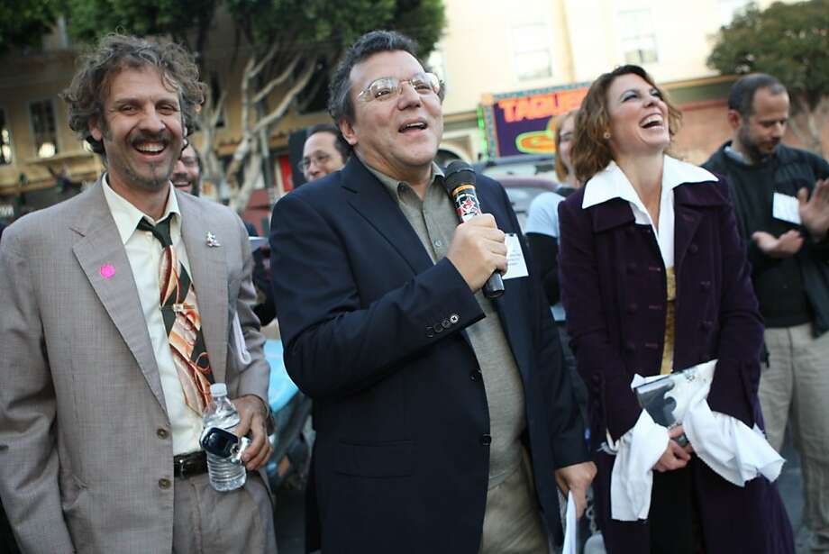 "Artist Brian Goggin (l to r) Luis Cancel, Director of Cultural Affairs, San Francisco Arts Commission and artist Dorka Keehn laugh while Cancel talks about the ""Language of the Birds"" art installation on the corner of Broadway and Columbus Streets in San Francisco, Calif. on Sunday, November 23, 2008. Photo: Lea Suzuki, The Chronicle"