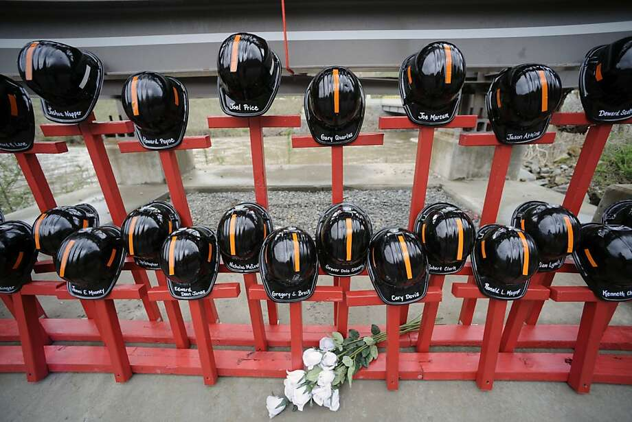 FILE - In this April 5, 2011 file photo, mine helmets and painted crosses sit at the entrance to Massey Energy's Upper Big Branch coal mine in Montcoal, W.Va., as the memorial represents the 29 coal miners who were killed in an explosion at the mine one year ago. Federal investigators say managers pressured coal miners to file fake reports to mislead safety inspectors before the fatal mine explosion, The Associated Press reports Wednesday, June 29, 2011. Photo: Jeff Gentner, AP