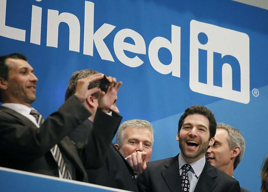 Jeff Weiner, second from right, LinkedIn's CEO, celebrates the company's  listing, Thursday, May 19, 2011 at the New York Stock Exchange. LinkedIn, based in Mountain View, Calif., is an internet-based social networking rolodex for business people. Photo: Mark Lennihan, AP