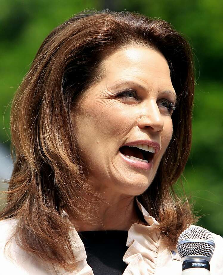 Republican presidential candidate, Rep. Michele Bachmann, R-Minn., talks with supporters during a campaign stop in Raymond, N.H., Tuesday, June 28, 2011. Photo: Jim Cole, AP