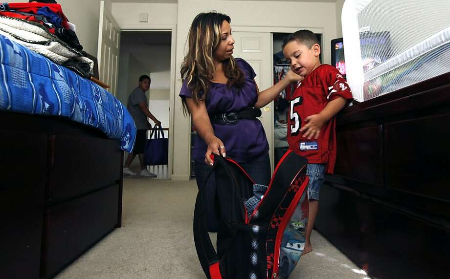 Alicia Alferez is raising her three sons Alexei Mendoza, 14 (rear), Jacob Fronco, 5 (not in photo) and Issaeih Fronco, 3, (right) on about $33,000 a year. Her kids are covered through Healthy Families program, a health program for kids from families slightly above Medi-Cal eligibility. Right now there are plans to raise copays for Healthy Families, but that may be held up temporarily. Wednesday, June 29, 2011 Photo: Lance Iversen, The Chronicle