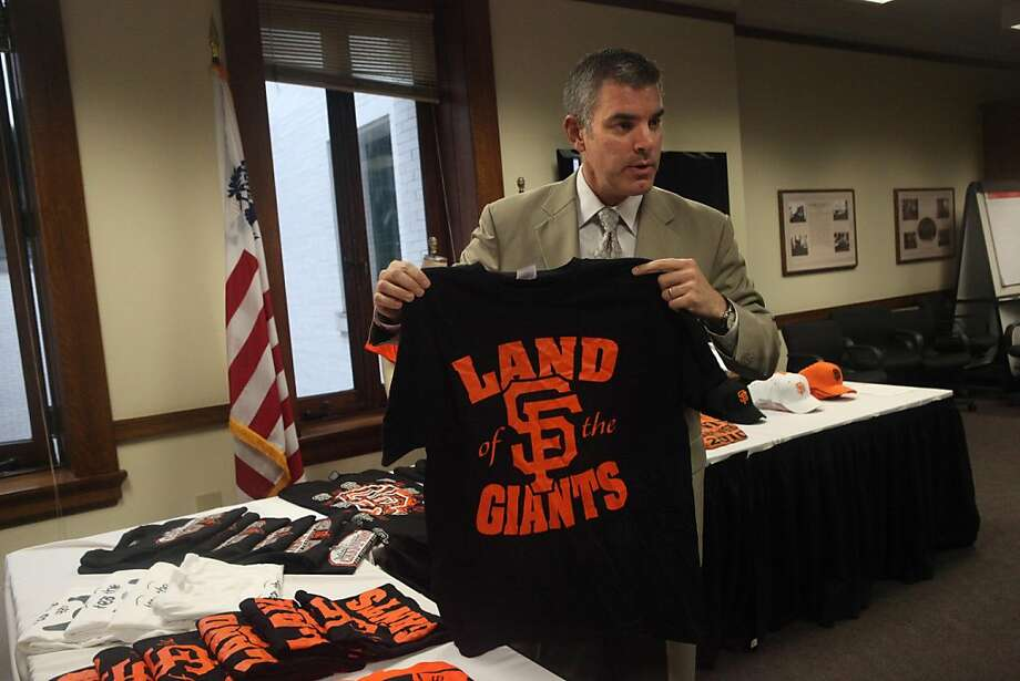 John Leonard, area port director, U.S. Customs and Border Patrol, holds up a counterfeit Giants shirt at U.S. Custom House on Tuesday, June 28, 2011 in San Francisco, Calif. Photo: Lea Suzuki, The Chronicle