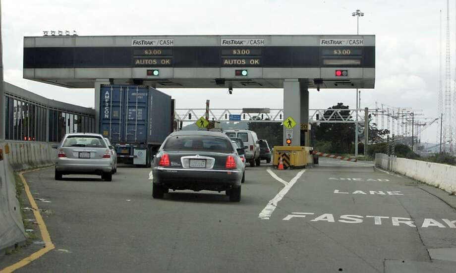 "FASTRAK_pg-038PG.JPG ItÕs been nearly a year since Caltrans and Bay Area transportation officials announced plans to entice more drivers to use FasTrak by giving users a temporary $1 discount, and by setting aside seven more lanes at four bridges to drivers who pay their tolls electronically. Well, the discount didnÕt work as well as it could have, and Caltrans officials, afraid of creating morning-long backups, have stalled plans to add more FasTrak electronic toll lanes at the Bay Bridge toll plaza. New lanes are also on hold at the Richmond-San Rafael and Benicia-Martinez bridges, where officials also worry about congestion. It would be great to get a shot of, say, the Bay Bridge Fastrak lanes, and/or the three ""setback"" tollbooths on the right (north) end of the toll plaza, which Caltrans is toying with turning into Fastrak lanes.   The San Francisco Chronicle, Penni Gladstone Photo taken on 3/23/05, in Oakland, Photo: Penni Gladstone, The Chronicle"