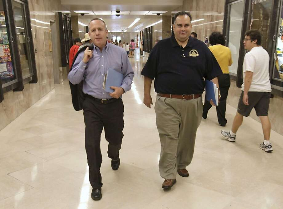 State Senate President Pro Tem Darrell Steinberg, D-Sacramento, Left, and Assembly Speaker John Perez, D-Los Angeles, walk through the Capitol after leaving a meeting with Gov. Jerry Brown in Sacramento,  Calif., Friday, June 24, 2011.  The two majority leaders met with the governor to discuss an alternative budget plan the governor could support if it were passed by a simple majority of Democrats. Photo: Rich Pedroncelli, AP