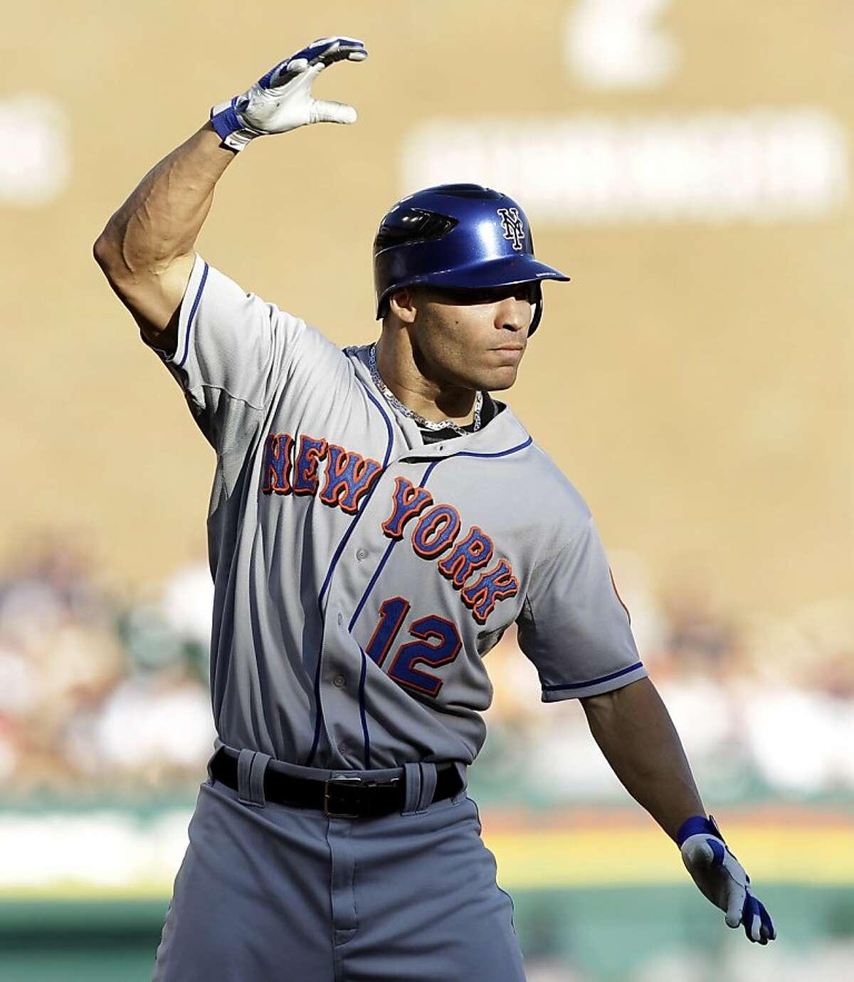New York Mets left fielder Scott Hairston celebrates hitting a three-run triple during the first inning of a baseball game against the Detroit Tigers, Wednesday, June 29, 2011, in Detroit.