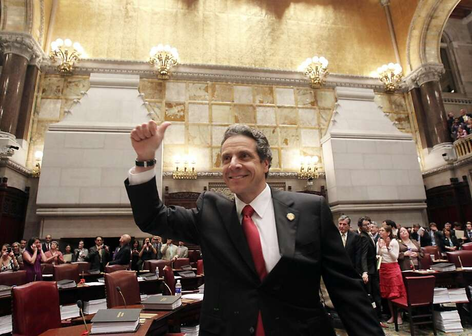 New York Gov. Andrew Cuomo reacts after same sex marriage was legalized after a vote in the Senate Chamber at the Capitol in Albany, N.Y., on Friday, June 24, 2011. Photo: Mike Groll, AP