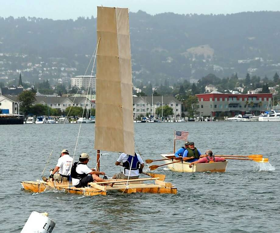 The rowboat beat the wingsail catamaran in the Summer Sailstice wooden boat building contest June 18 in Alameda. Both were built in eight hours. Photo: Larry Barnett / Sailstice