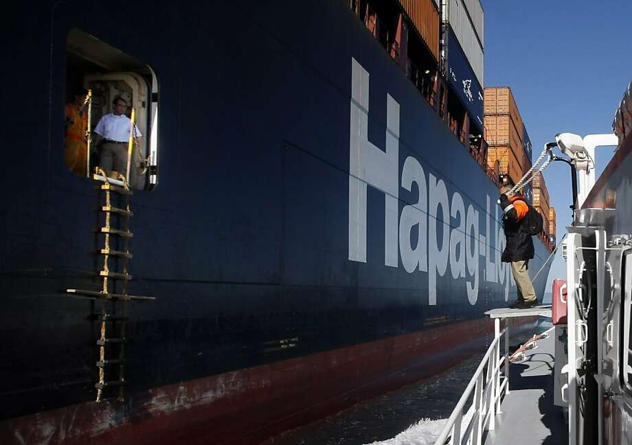 The pilot boat San Francisco comes along side a container ship as a pilot, Steve Teague prepares to board the ship Monday, September 27, 2010, San Francisco, Calif.  The San Francisco Bar Pilots have been organized since 1850, but pilots have lead ships into the San Francisco Bay going back as far as the 1830s. Photo: Adm Golub, The Chronicle