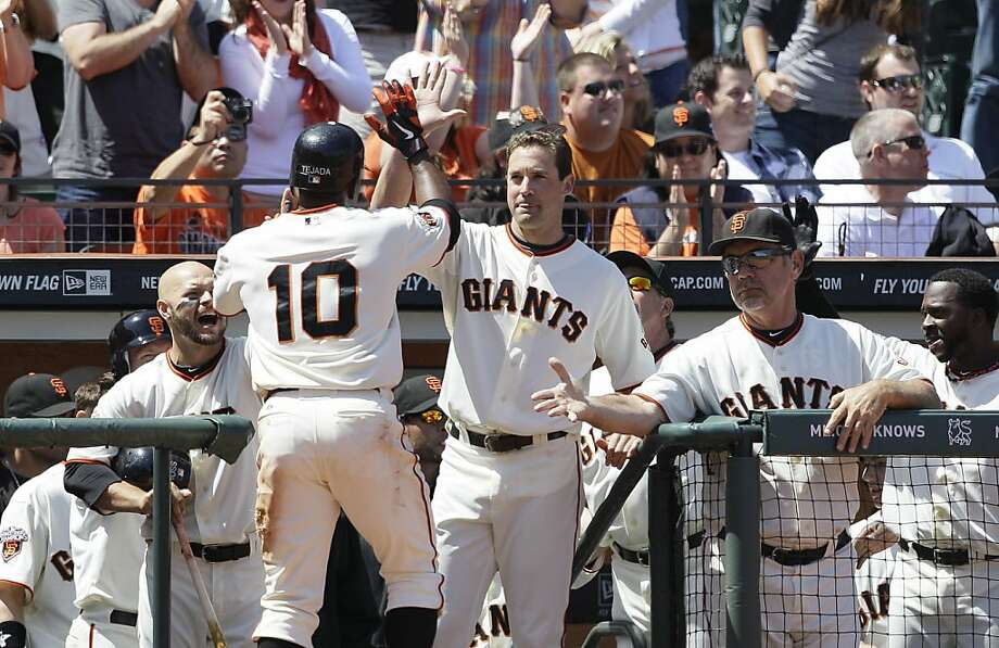 San Francisco Giants' Miguel Tejada (10) is congratulated by teammates Cody Ross, left, Pat Burrell, center, and manager Bruce Bochy after scoring on a balk by Cleveland Indians relief pitcher Tony Sipp in the seventh inning of an interleague baseball game in San Francisco, Saturday, June 25, 2011. Photo: Jeff Chiu, AP