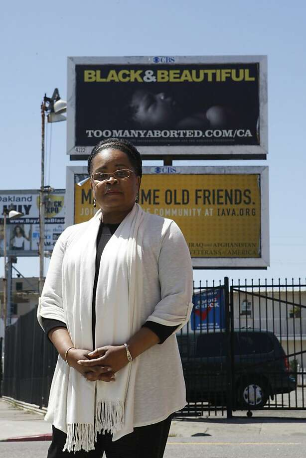 Belle Taylor-McGhee stands in front of anti-abortion billboards that target black women on Friday, June 24, 2011 in Oakland, Calif. Taylor-McGhee believes the signs are offensive to black women and works to have them removed. Photo: Michelle Terris, The Chronicle