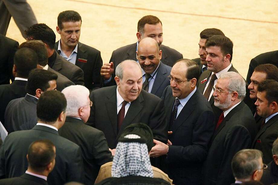 Former Prime Minister Ayad Allawi, center left and Prime Minister Nouri al-Maliki, center right, are seen after the first session of Iraqi Parliament in Baghdad, Iraq, Monday, June 14, 2010.  In parliament, al-Maliki watched as his chief rival, Ayad Allawi, who heads the Iraqiya bloc, and other lawmakers stood to take the oath of office in Arabic and Kurdish. Photo: Hadi Mizban, AP