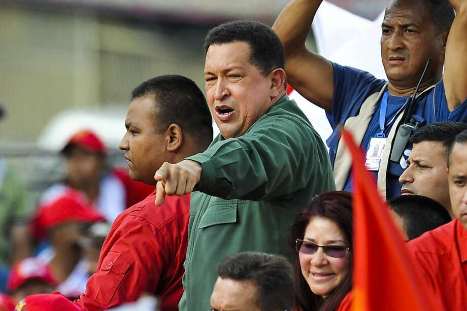 Venezuelan President Hugo Chavez gestures during a May Day rally in Caracas, Venezuela, on May 1, 2011. Chavez announced a plan to create more than three million jobs over the next eight years in Venezuela, where unemployment hovers around 9%, according to official figures. AFP Photo / Leo RAMIREZ (Photo credit should read LEO RAMIREZ/AFP/Getty Images) Photo: Leo Ramirez, AFP/Getty Images