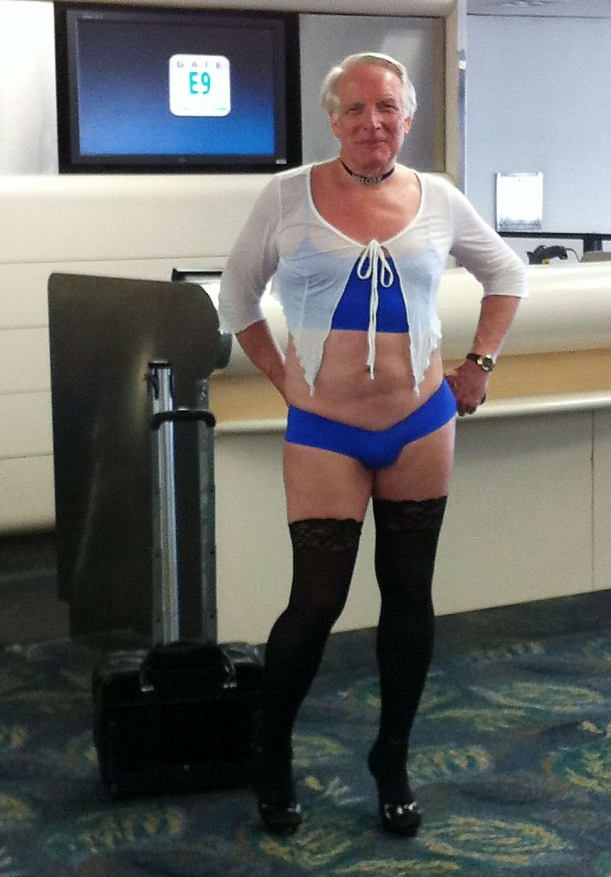 This is a June 9, 2011 photo provided by airline passenger Jill Tarlow shows an unnamed passenger scantily dressed and taken at the airport in Fort Lauderdale, Fla. US Airways is defending its decision to allow the man wearing skimpy women's panties and high heels to fly days before a football player was arrested on a plane in California over a dispute over his saggy pants. The man flew six days before University of New Mexico football player Deshon Marman was arrested on a US Airways flight in San Francisco over allegations he refused to pull up his pants. A US Airways spokeswoman told the San Francisco Chronicle employees were right not to ask the man on the Phoenix flight to cover himself but declined to comment on Marman's arrest.