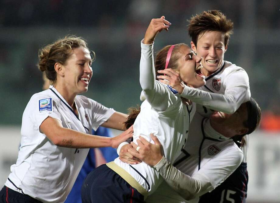 United States' Alex Morgan, center, reacts with teammates after she scoring during their Women's World Cup 2011 soccer first leg play off match against Italy, at Euganeo stadium in Padua, Italy, Saturday, Nov. 20, 2010. The United States won 1-0. Photo: Felice Calabro', AP