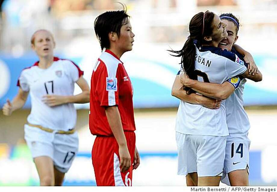 US Alex Morgan (C) celebrates with Keelin Winters (R) after scoring against North Korea during their FIFA U20 Women's World Cup 2008 final at the Municipal Florida Stadium on December 7, 2008. AFP PHOTO / Martin Bernetti (Photo credit should read MARTIN BERNETTI/AFP/Getty Images) Photo: Martin Bernetti, AFP/Getty Images