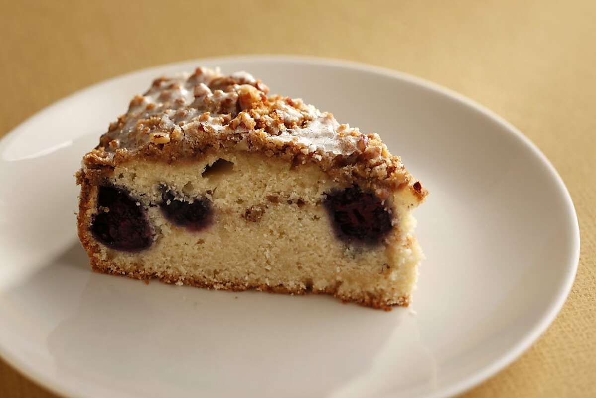 This blackberry crunch cake has a layer of berries hidden in the center. Food styled by Rochelle Vurek.