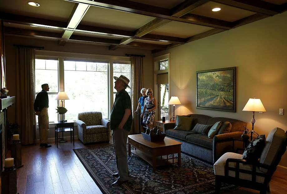 Visitors look over the Calistoga bungalow, the only model presently on the grounds. A new continuous care housing development for LGBT seniors is being realized at Fountaingrove Lodge in the hills above Santa Rosa, Calif. Photo: Brant Ward, The Chronicle