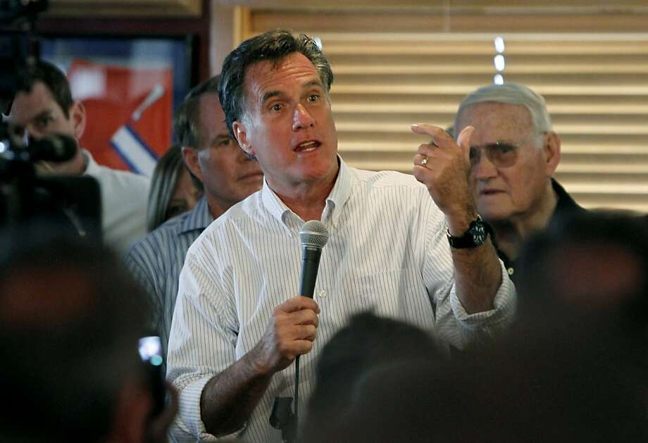 Republican presidential candidate Mitt Romney speaks as he campaigns at a bar and restaurant  in Aurora, Colo., on Monday, June 20, 2011.  The former Massachusetts governor returned to Colorado for the first time as a presidential candidate Monday, more than three years since he easily won the state's presidential caucuses over the eventual Republican nominee, Sen. John McCain. Photo: Ed Andrieski, AP