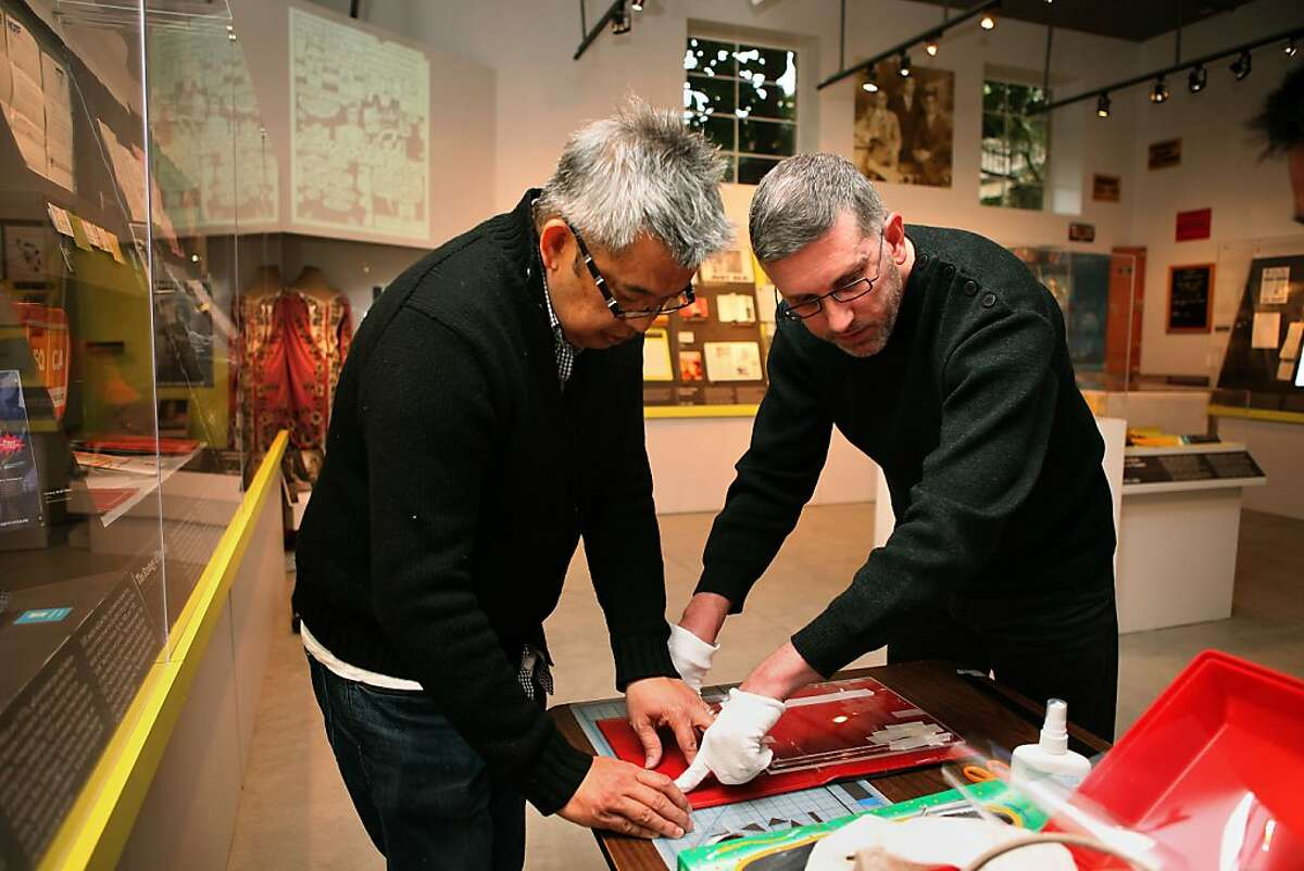 Exhibition consultant Ramone Silvestre (left) and curator Gerard Koskovich (right) do last minute preparations for the January 11, 2011 opening of the GLBT (gay, lesbian, bisexual, transexual) history museum in the Castro in San Francisco, Calif.