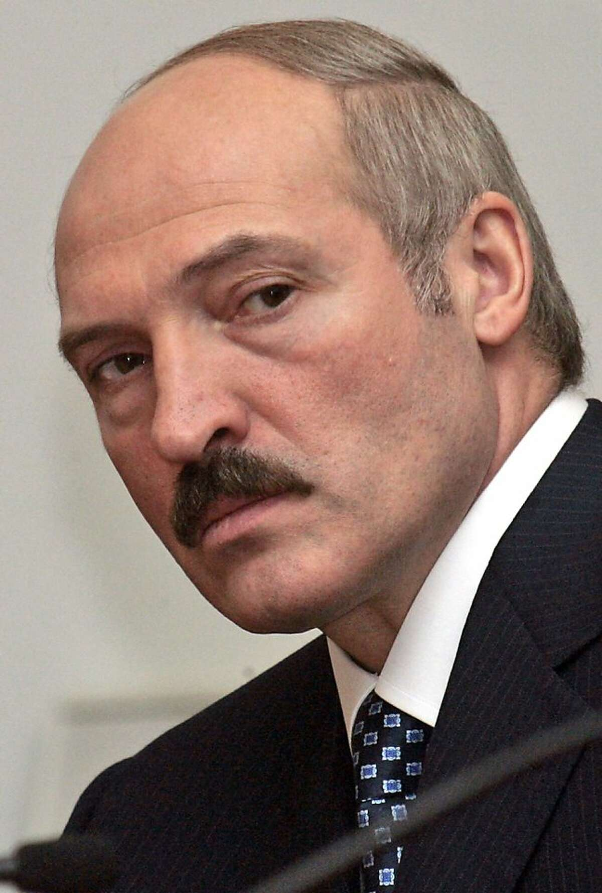 Belarusian President Alexander Lukashenko looks on at a news conference after a summit of the Eurasian Economic Community in St. Petersburg, Russia, in this Wednesday, Jan. 25, 2006, file photo. With just hours to go before a threatened cutoff of natural gas to Belarus, Russia's gas monopoly and Belarusian officials on Sunday resumed tense talks over Russia's demand for a 125-percent rate hike. The politically charged dispute reflects strained relations between Belarus and Russia, whose close ties go back centuries but have been increasingly tense in recent years as Russian President Vladimir Putin's Kremlin has apparently tired of providing political and economic support for Lukashenko.