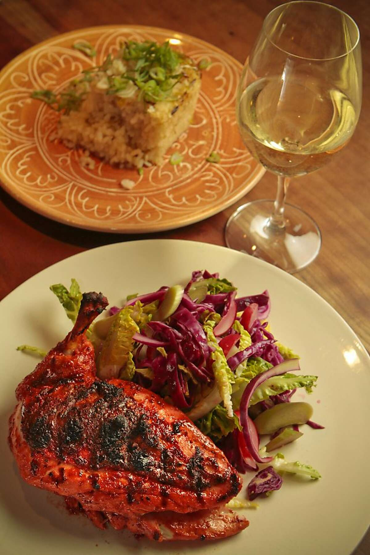 Yucatan-Style grilled chicken with Baked Rice and a Sauvignon Blanc is seen in Napa, Calif. on Monday May 16th, 2011.