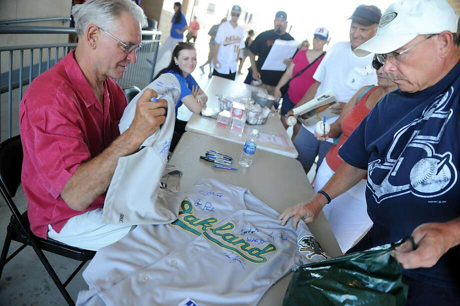 Dave Kingman, left, checks some autographs after signing a jersey for Robert Paine before the start of the Stockton Ports Rancho Cucamonga game in Stockton Ballpark, June 19, 2011. Photo: Calixtro Romias, CALIXTRO ROMIAS/The Record