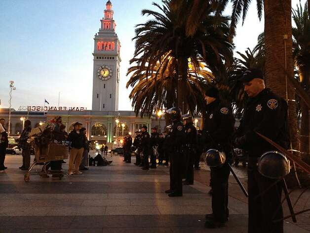 Police on Justin Herman plaza after clearing San Francisco's Occupy camp before dawn on December 7, 2011. Seventy were arrested police said. Photo: Will Kane, The Chronicle
