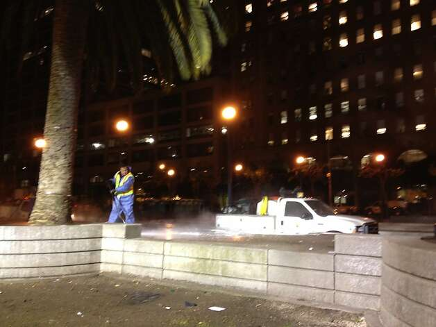 City public works crews power wash Justin Herman Plaza after police cleared out the Occupy camp before dawn on Wednesday, December 7, 2011. Photo: Will Kane, The Chronicle