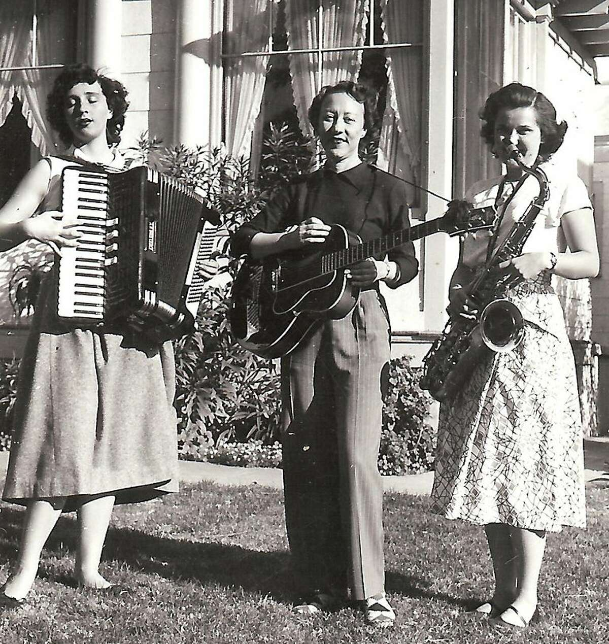 Evelyn Deane, right, had a vibrant career as a saxophonist before becoming a lawyer