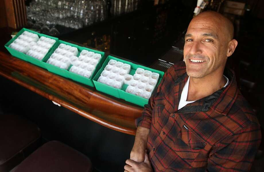 Paul Marino, owner of Columbus Cafe, ordered poker chips for his bar but when he opened the packages shipped by UPS found over $80,000 of silver coins where inside. Marino returned the missed handled packages on Friday, the same day he discovered the mistake. Photo: Mathew Sumner, Special To The Chronicle
