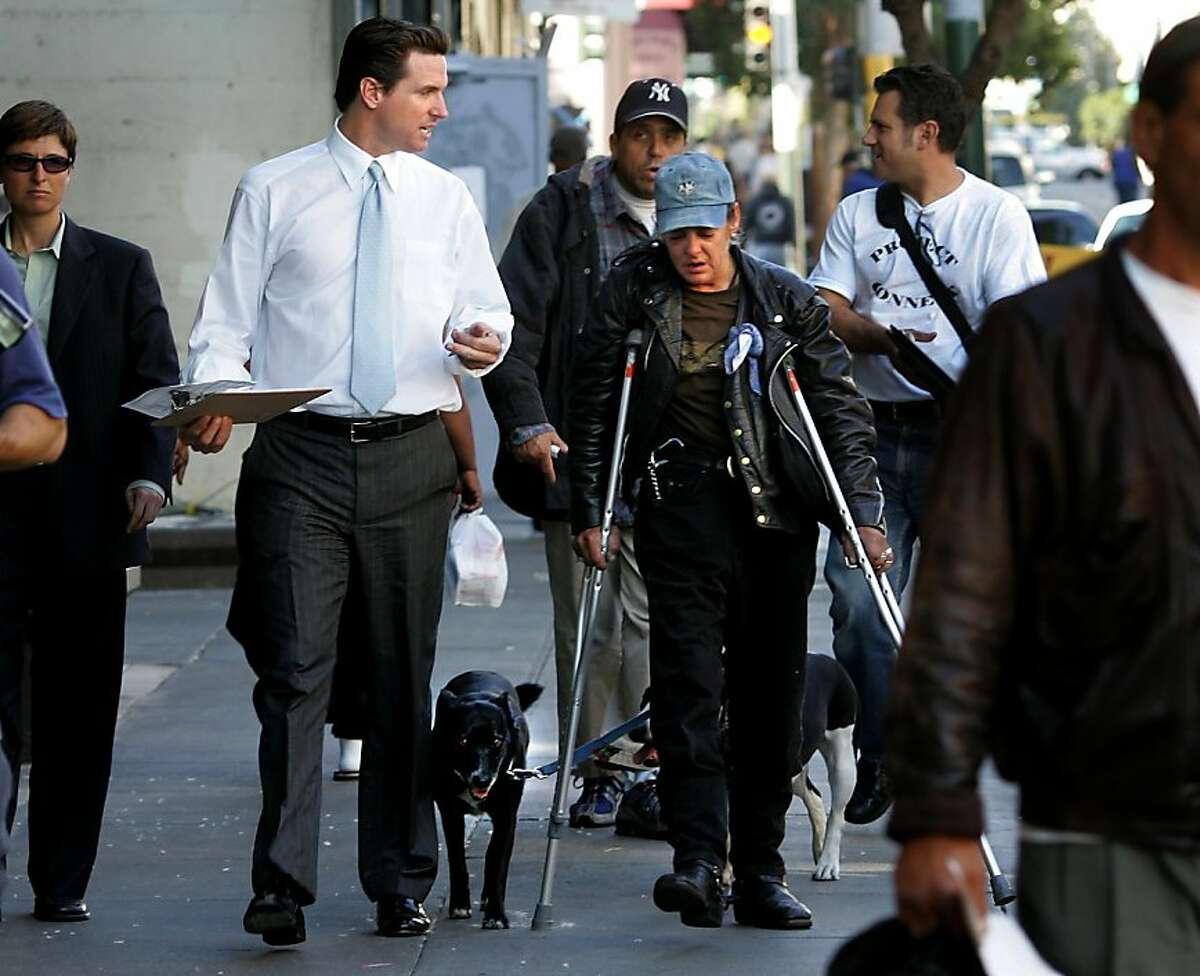 File photo from 2004. Mayor Newsom (left in white shirt) walks the streets of the Tenderloin to talk with the homeless about his new Care Not Cash program. File photographs from 2004. Mayor Newsom begins his Care Not Cash program with a tour of the McAllister Hotel and the Tenderloin homeless situation.