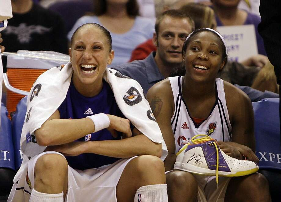 Phoenix Mercury players Diana Taurasi, left, and Cappie Pondexter smile on the bench in the closing moments of the Mercury's victory over the Chicago Sky in the fourth quarter of a basketball game Wednesday, July 8, 2009, in Phoenix.  Taurasi scored 22 points and Pondexter added 16 as the Mercury defeated the Sky 90-70. (AP Photo/Ross D. Franklin) Photo: Ross D. Franklin, AP