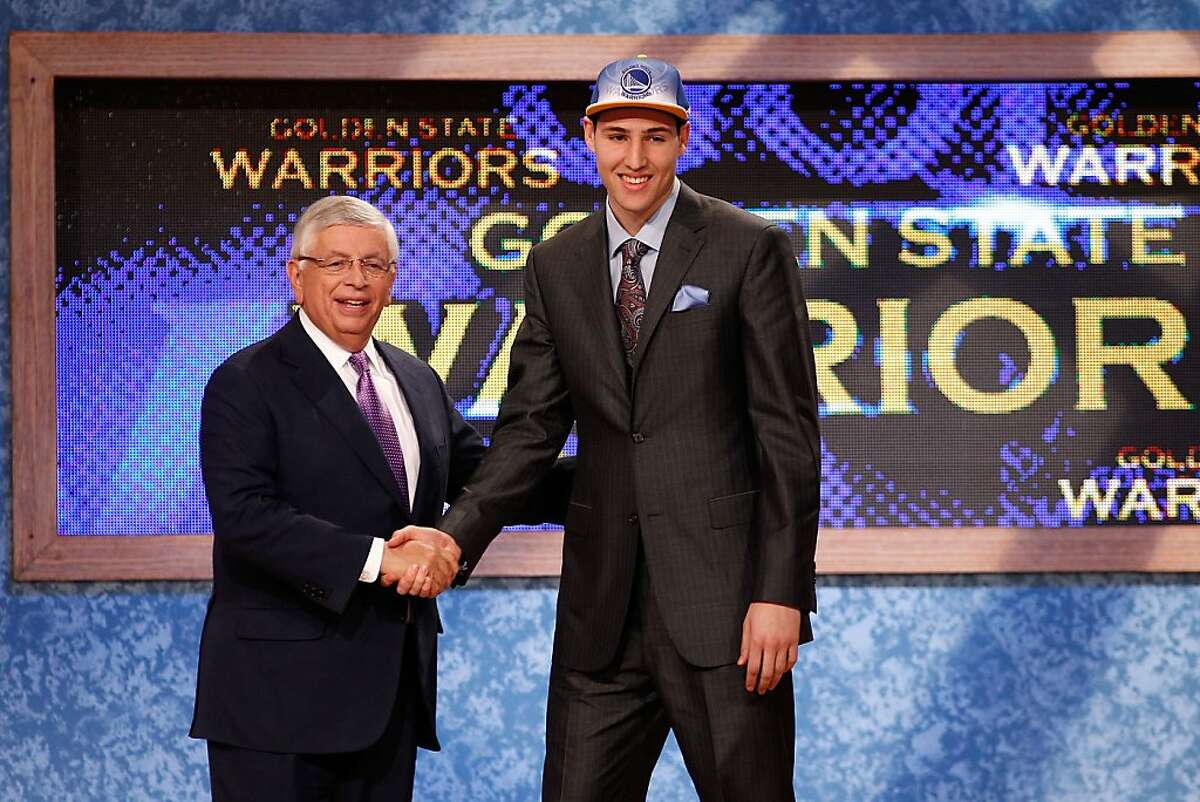 NEWARK, NJ - JUNE 23: Klay Thompson from Washington State greets NBA Commissioner David Stern after he was selected #11 overall by the Golden State Warriors in the first round during the 2011 NBA Draft at the Prudential Center on June 23, 2011 in Newark,New Jersey.