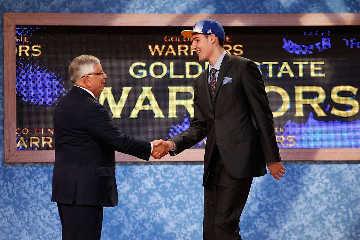 Klay Thompson from Washington State greets NBA Commissioner David Stern after he was selected #11 overall by the Golden State Warriors in the first round during the 2011 NBA Draft at the Prudential Center on June 23, 2011 in Newark,New Jersey.